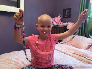"Neave with her ""Bravery Beads"""
